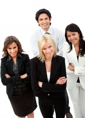 group of business people smiling isolated over a white background